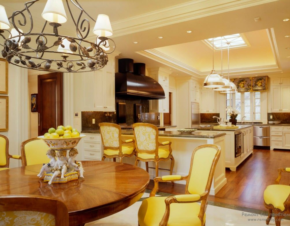Greek Interior Design Style: Antiquity in Your Home. Beige colored living room with open styled kitchen