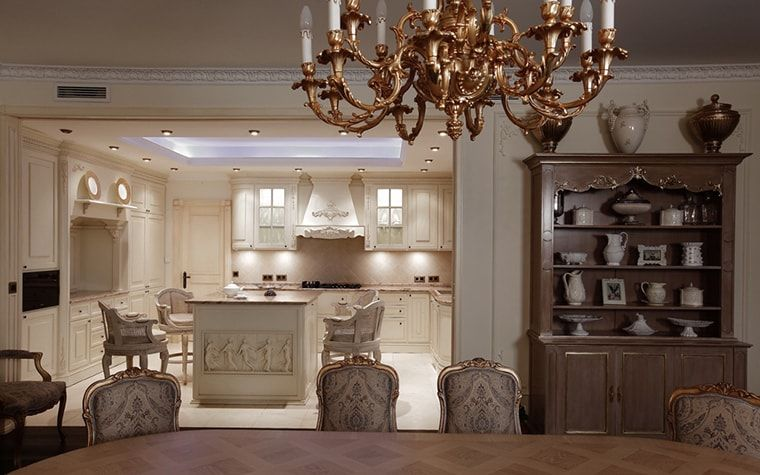 Italian Dining Room & Kitchen Combined in One Space. Royal gilded chandelier with Classic set interior and modern LED backlight