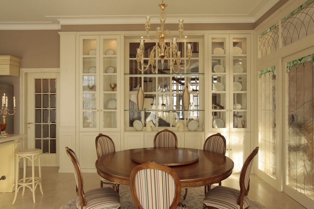 Italian Dining Room & Kitchen Combined in One Space. Sash window of the glazed furniture set and round wooden table