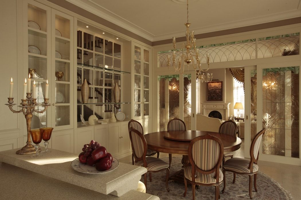 Italian Dining Room & Kitchen Combined in One Space. Beige colored ethnic design of the kitchen