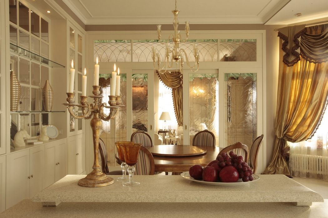 Italian Dining Room & Kitchen Combined in One Space. Chandelier and candlestick call up in same stylistic