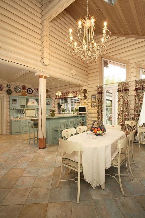 Wooden logs built kitchen in creamy color and ceramic tiled floor