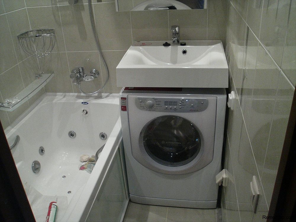 Washing Machine in Small Bathroom Placement Ideas. Exposed washing machine righ at the high sink