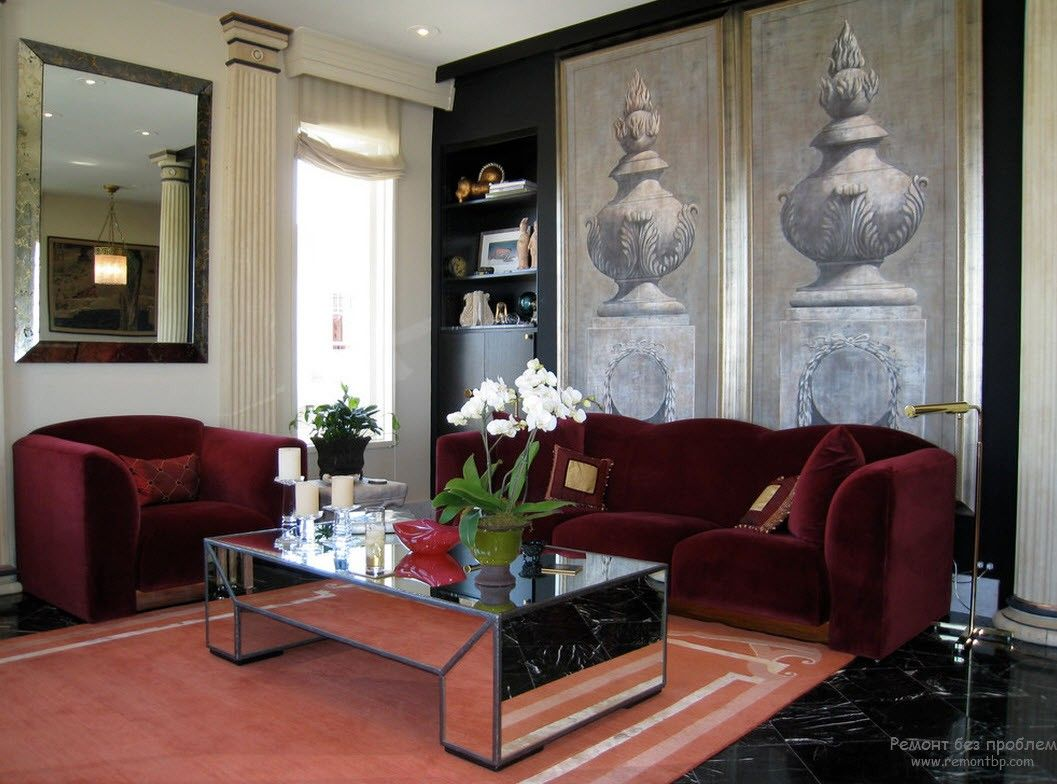 Greek Interior Design Style: Antiquity in Your Home. Mirroring coffee table and deep red upholstered furniture for Classic living room