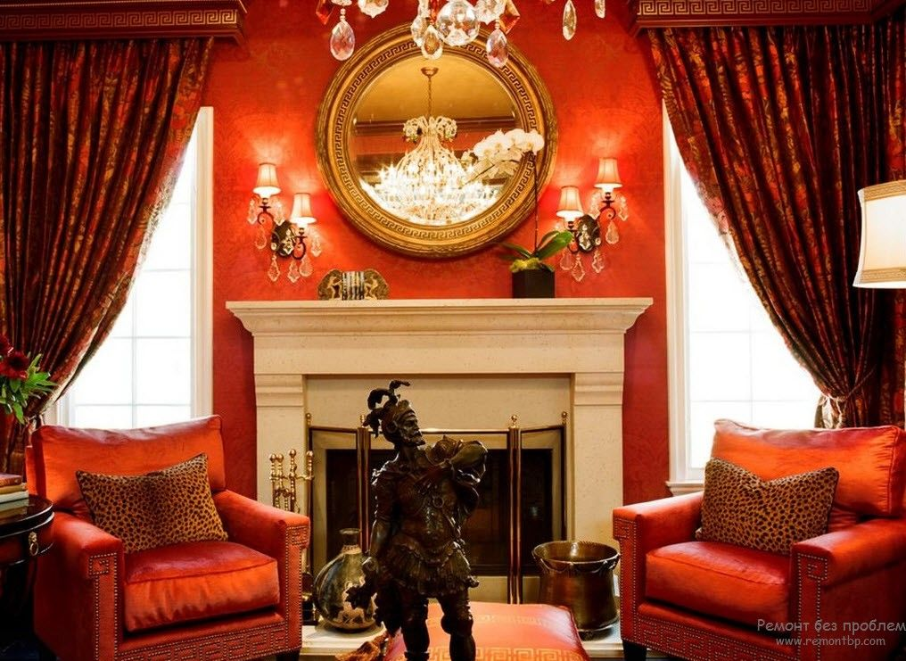 Royal decoration for small living room with red color scheme and Greek gods' figurines