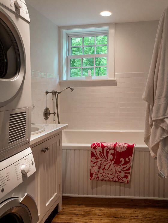 Washing Machine in Small Bathroom Placement Ideas. Gray classic bathroom with window and drying, washing machines