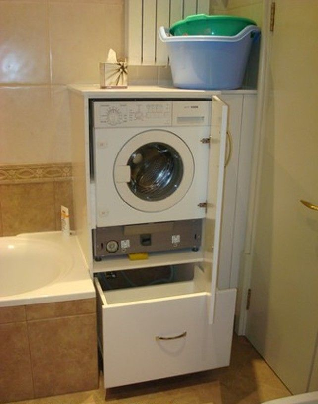 Unusuall furniture in the bathroom with built-in washing machine and a drawer