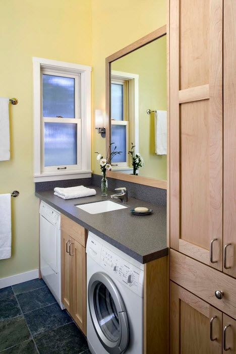 Washing Machine in Small Bathroom Placement Ideas. Green painted walls for modern bathroom with multifunctional vanity
