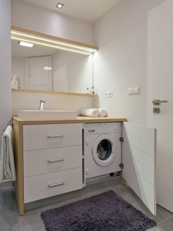 Washing Machine in Small Bathroom Placement Ideas. Powder color for vanity and mirror frame in the modern styled space