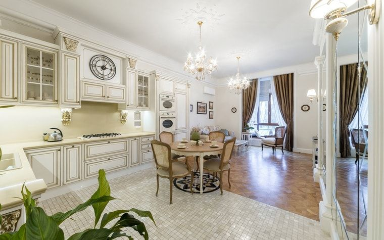 Italian Dining Room & Kitchen Combined in One Space. White decorated kitchen with two-zoned floor