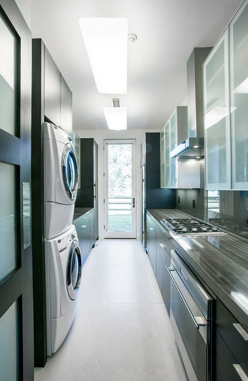 Ultramodern kitchen space with galley layout and steel surfaces