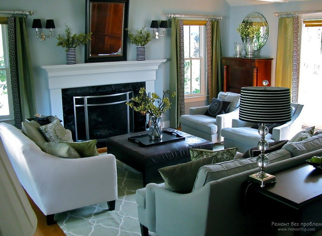 Greek Interior Design Style: Antiquity in Your Home. Simple homey design for the living room with metal framed fireplace