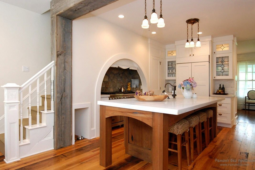 Greek Interior Design Style: Antiquity in Your Home. White designed kitchen with white plastic table top and wooden framed entrance