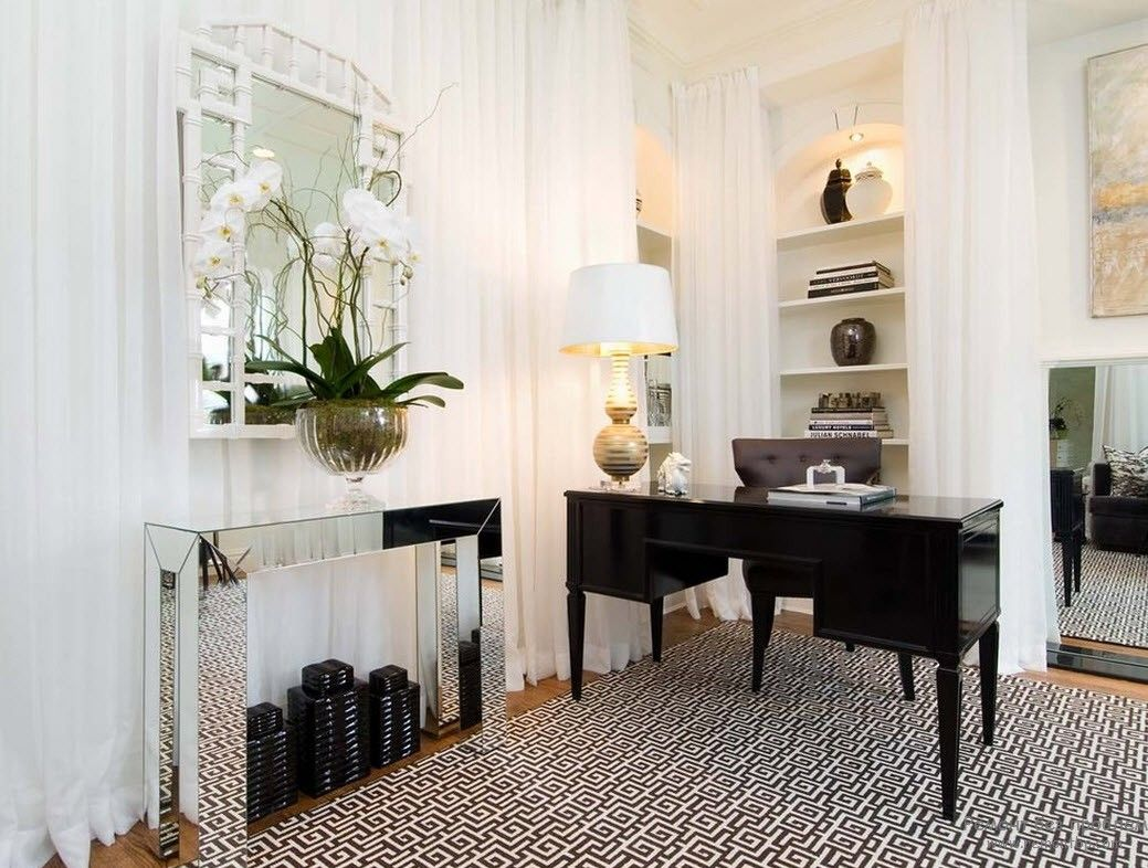 Aristocratic look of the light decorated interior with black table