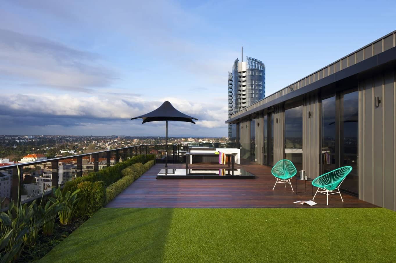 Top 10 Small Apartment Patio Ideas with Photos. A real-life lawn at the top of the skyscraper with the patio zone