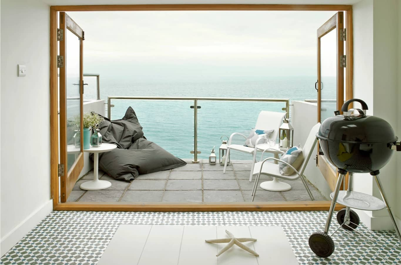 Top 10 Small Apartment Patio Ideas with Photos. Panoramic window to the balcony in the modern oceanside condo