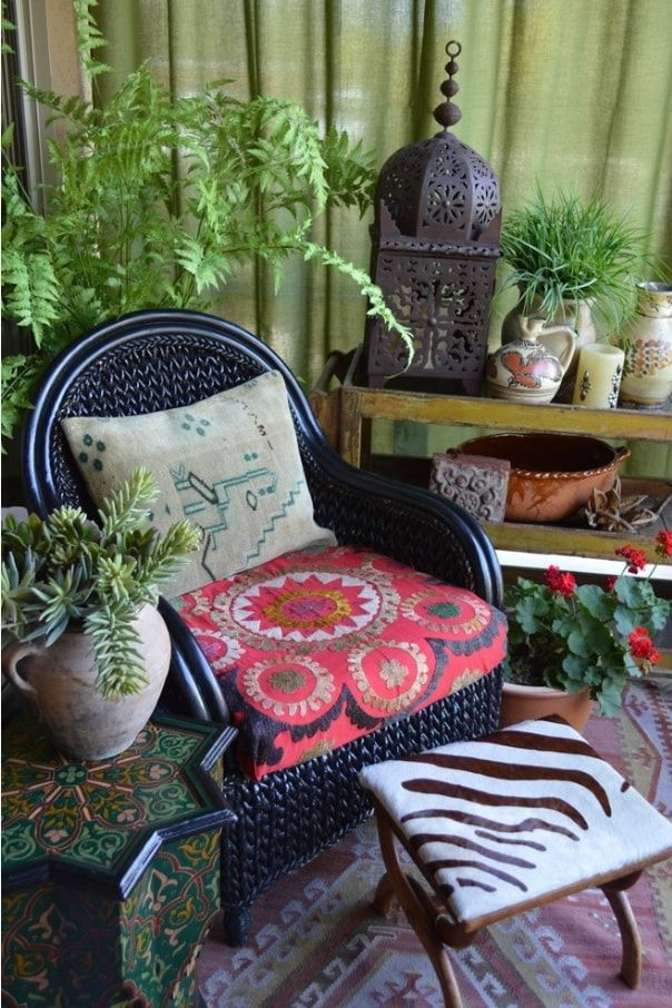 Top 10 Small Apartment Patio Ideas with Photos. Eco styled area with greenery, cozy rattan chair and a plaid