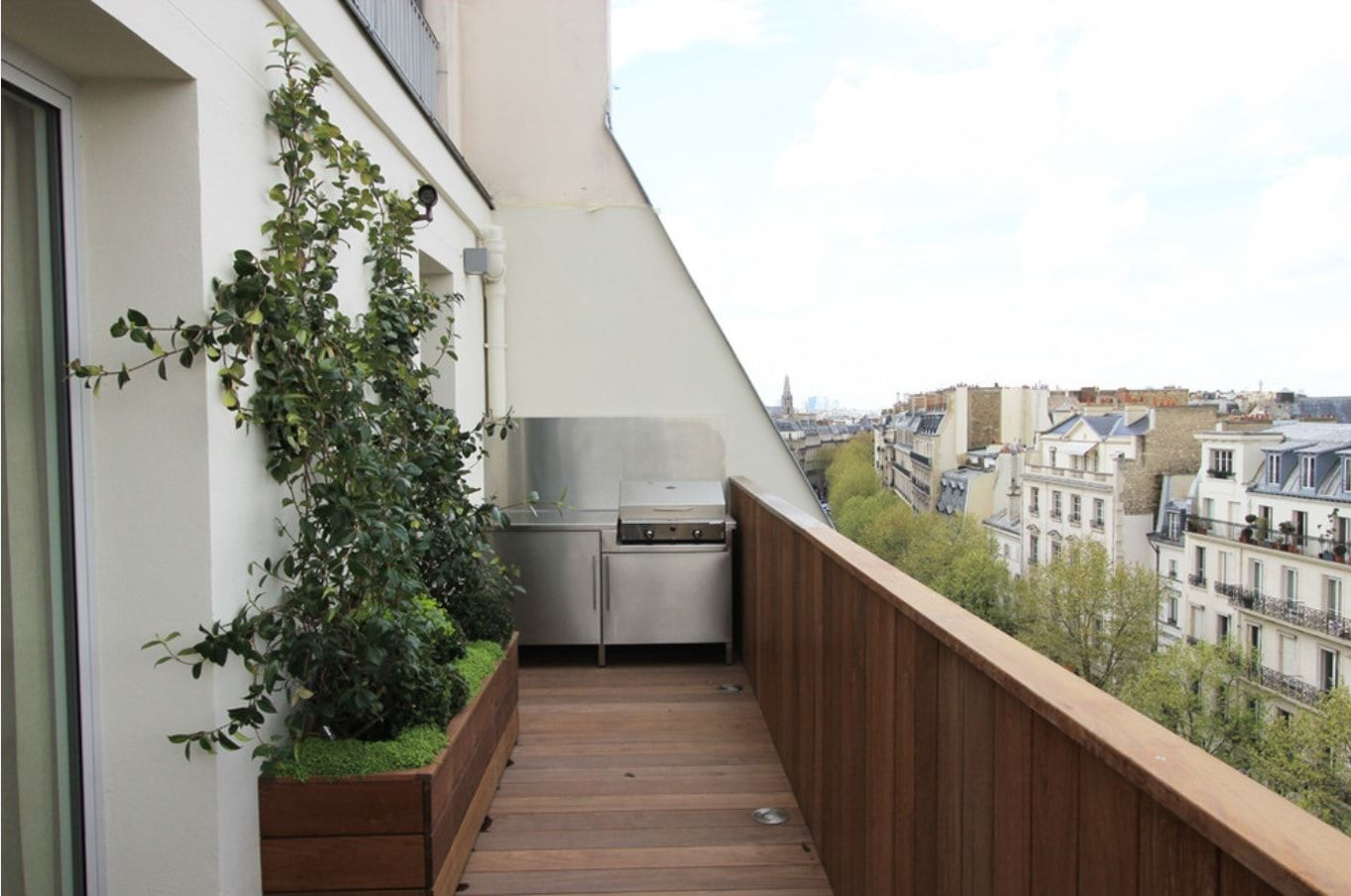 Top 10 Small Apartment Patio Ideas with Photos. Wooden trimmed patio zone at the common loggia at the facade of residential building