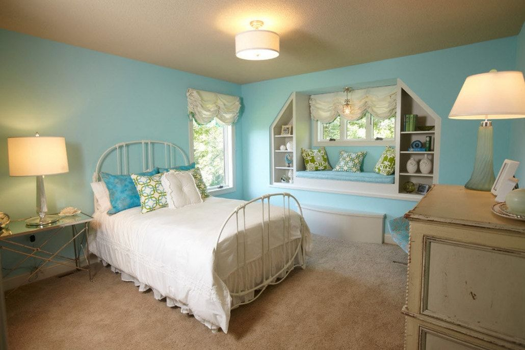 Azure cold colored kids' room with metal framed bed