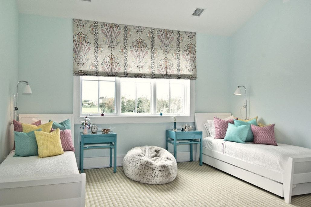 Pale blue walls for modern styled children's room for two