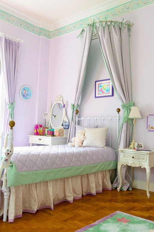 Light purple decorated walls in classic styled room with tulle above the bed