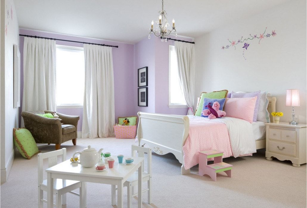Large kids' room with the playground, violet walls and white tulle curtains