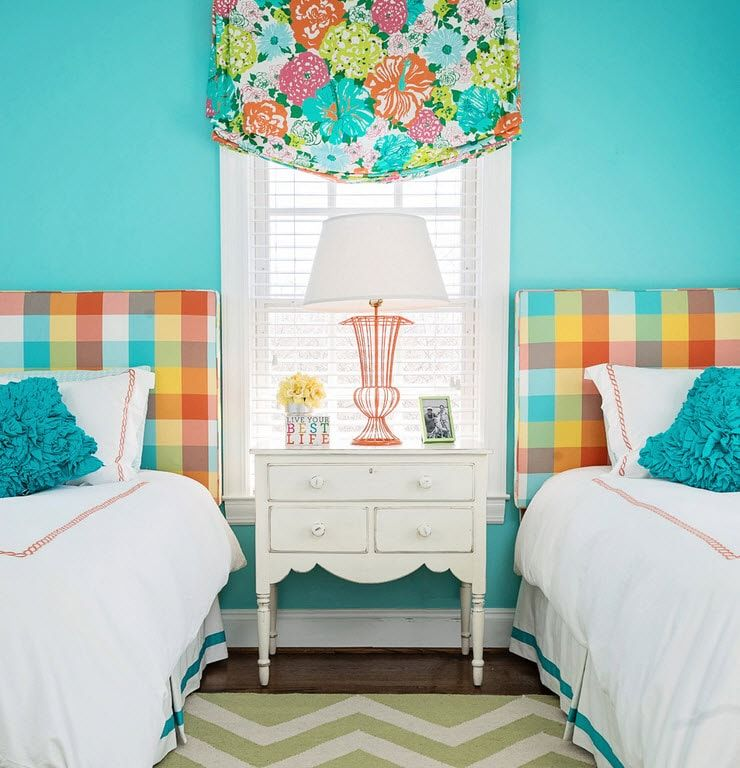 Turuoise wall with the colorful pattern for Rustic styled kids' room for two