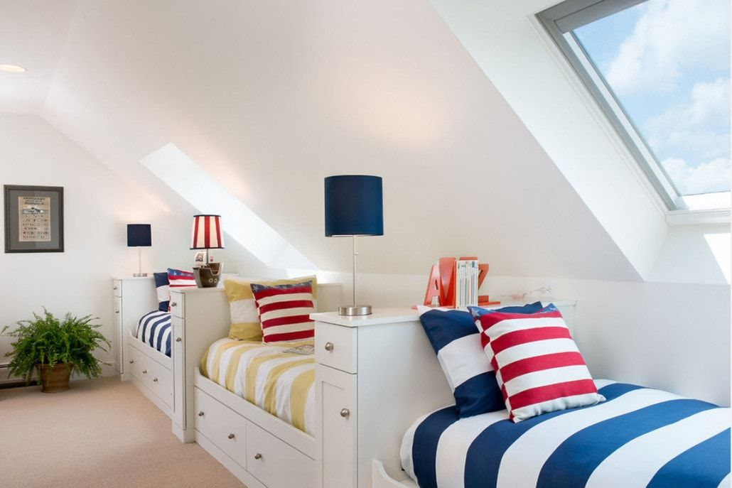 Striped bedding for the loft children's room with beds at the ideally white wall