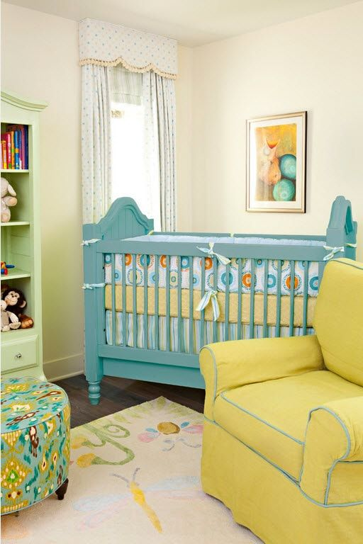 Yellow colored classic chair and blue crib