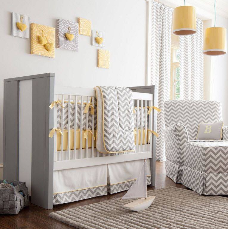 Gray modern crib in the neutral toned room