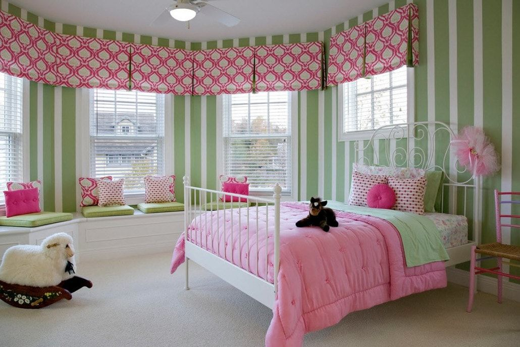 Color Therapy for Children's Room: Why Need Proper Color Combination? Bay window room with panoramic windows and striped wallpaper along with polka-dot curtains