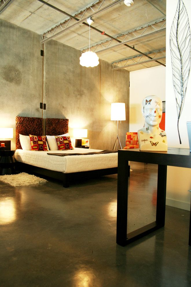 Gray designed industrial bedroom full of artificial lighting and faux concreted walls