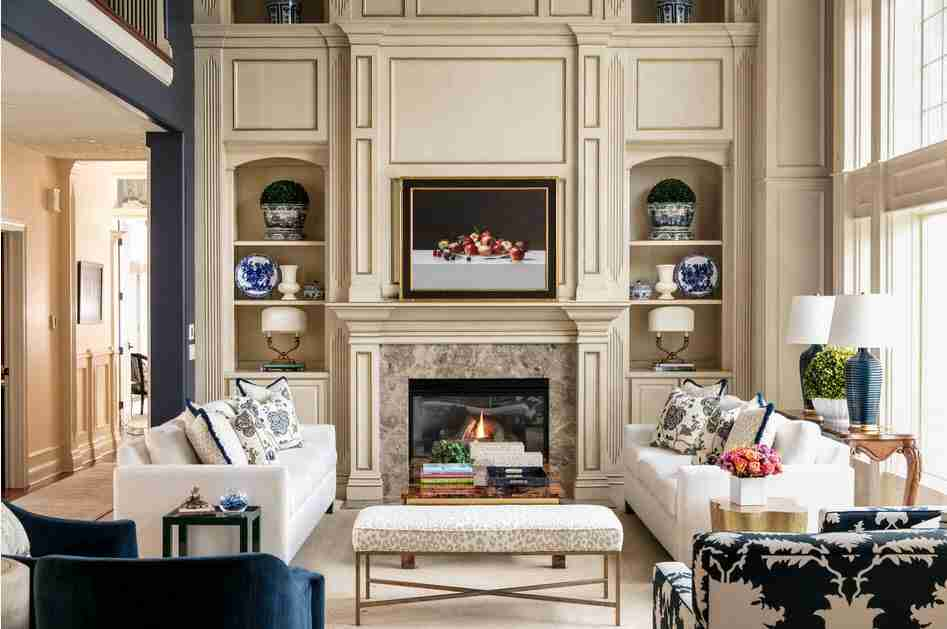 Pilasters in the Interior - Indispensable Element of Luxurious Design. Ivory colored noble living room with fireplace and picture at the accent wall
