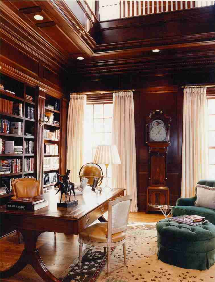 Pilasters in the Interior - Indispensable Element of Luxurious Design. Noble wooden trimmed interior with library zone