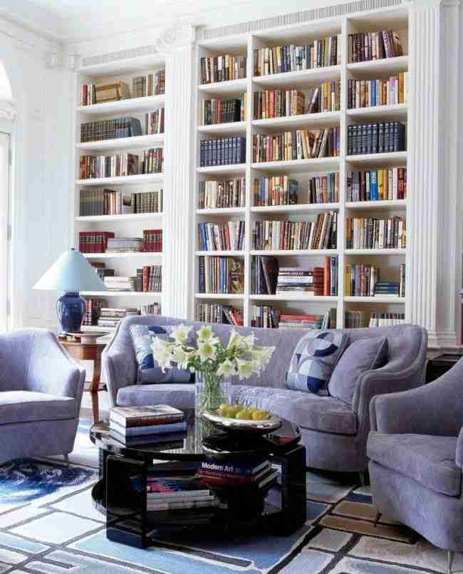 Pilasters in the Interior - Indispensable Element of Luxurious Design. Soft furniture and book shelving in classic interior