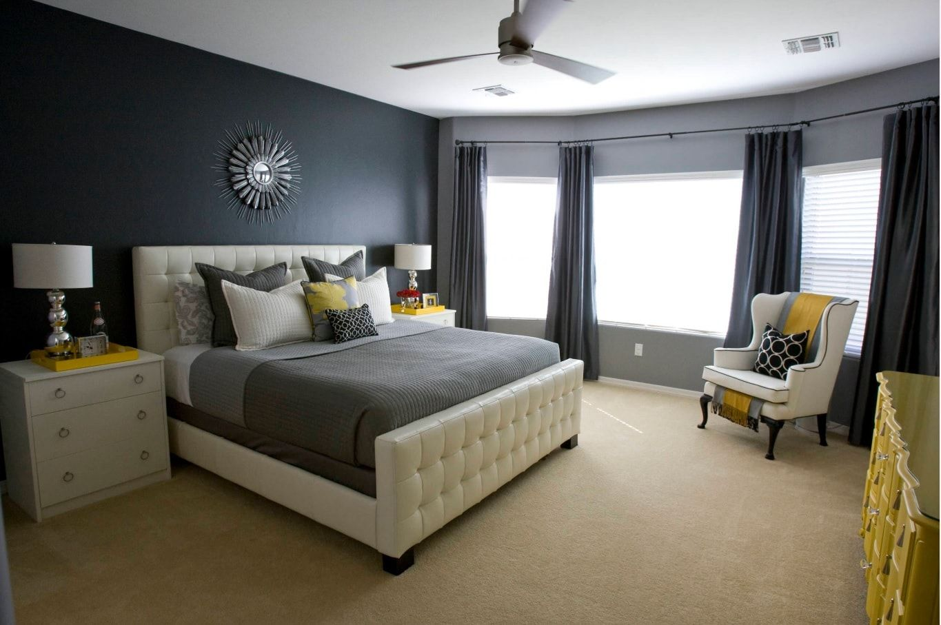 10 Top Secret Decorating Tips for Selling Your Home. Quilted creamy colored legboard in the gray colored bedroom