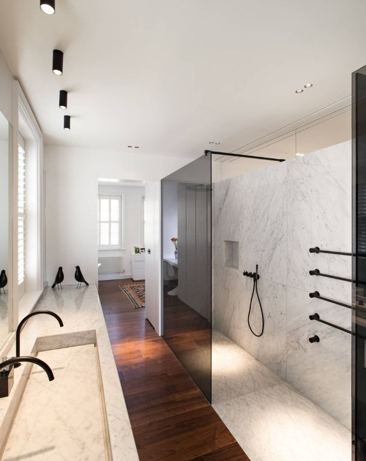 10 Top Secret Decorating Tips for Selling Your Home. Gorgeous minimalistic modern bathroom with dark glass separated shower zone and black taps