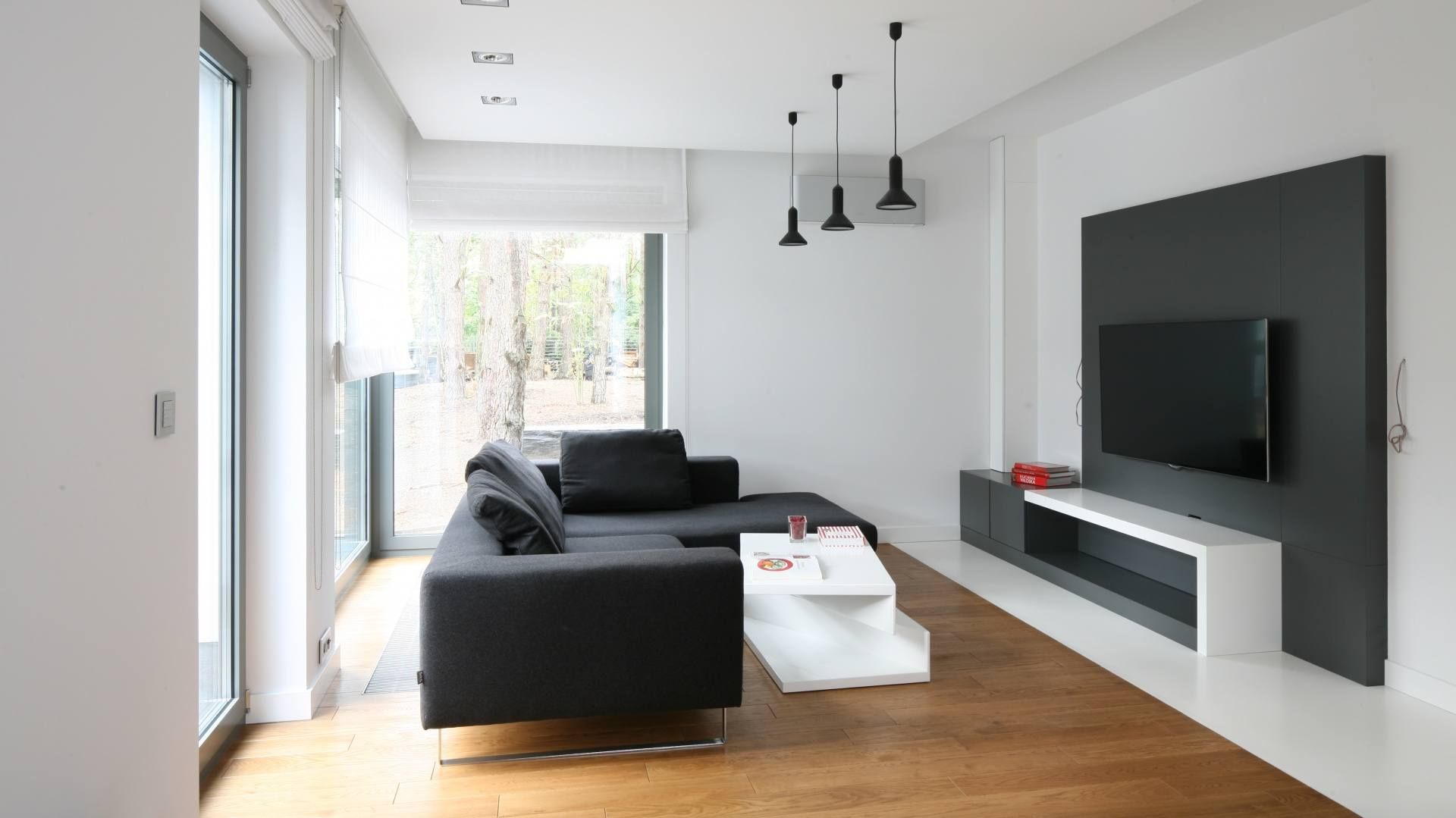 Black Sofa: Elegant and Original Design for Flawless Interior. Nice modern design of the room with black lamps in the living zone