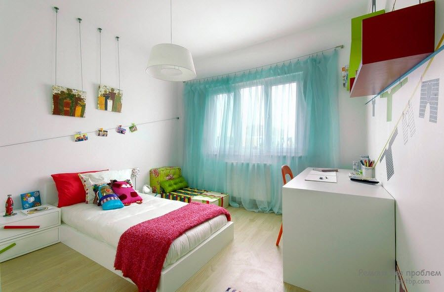Curtains in the Interior of the Children's Room. Turquoise tulle on the window and the crimson coverlet on the bed