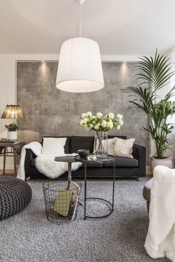 Black Sofa: Elegant and Original Design for Flawless Interior. Gray accent wall at the industrial style room
