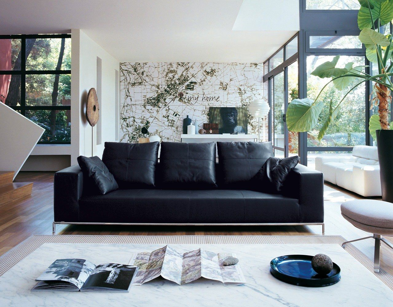 Black Sofa: Elegant and Original Design for Flawless Interior. Modern interior with panoramic windows and accent central piece