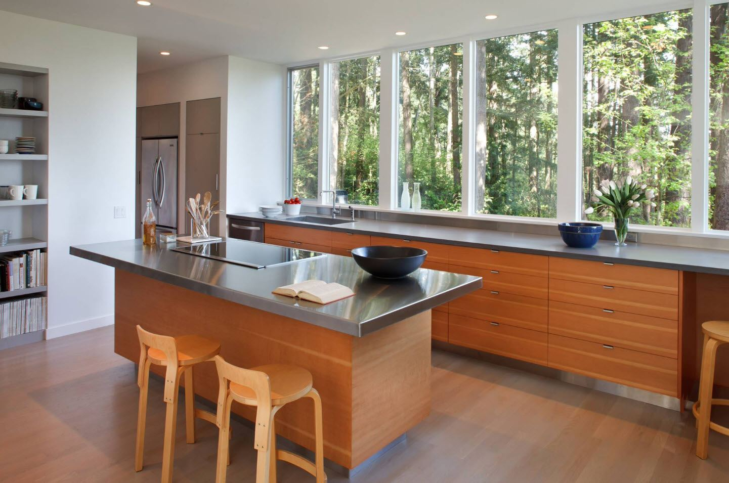 Cottage kitchen with wooden trimming. large window and glossy dark countertops