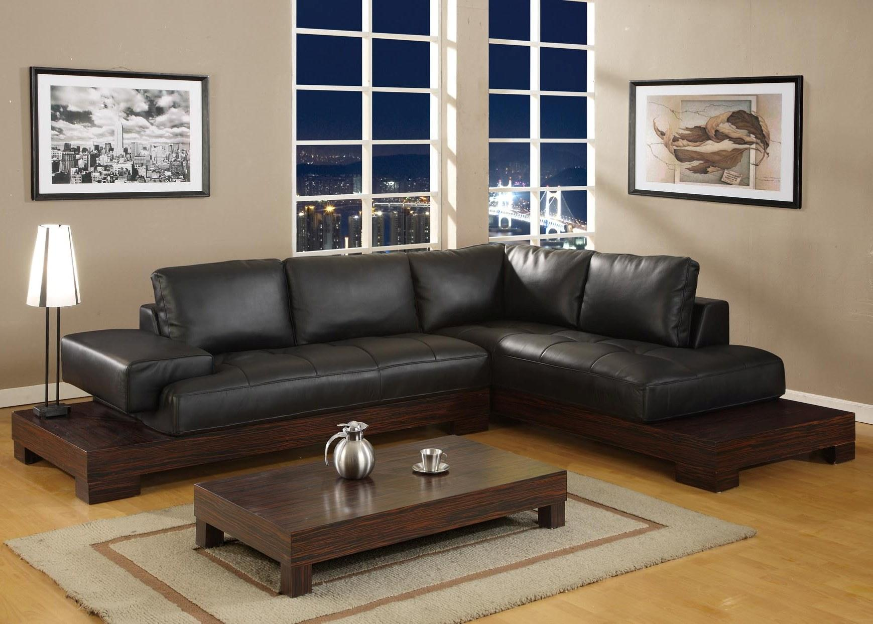 Black Sofa: Elegant and Original Design for Flawless Interior. Angular leather upholstered sofa and low coffee table for casual interior