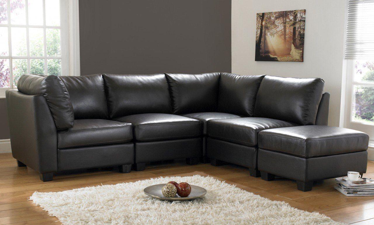 Chic angular sofa and fluffy rug