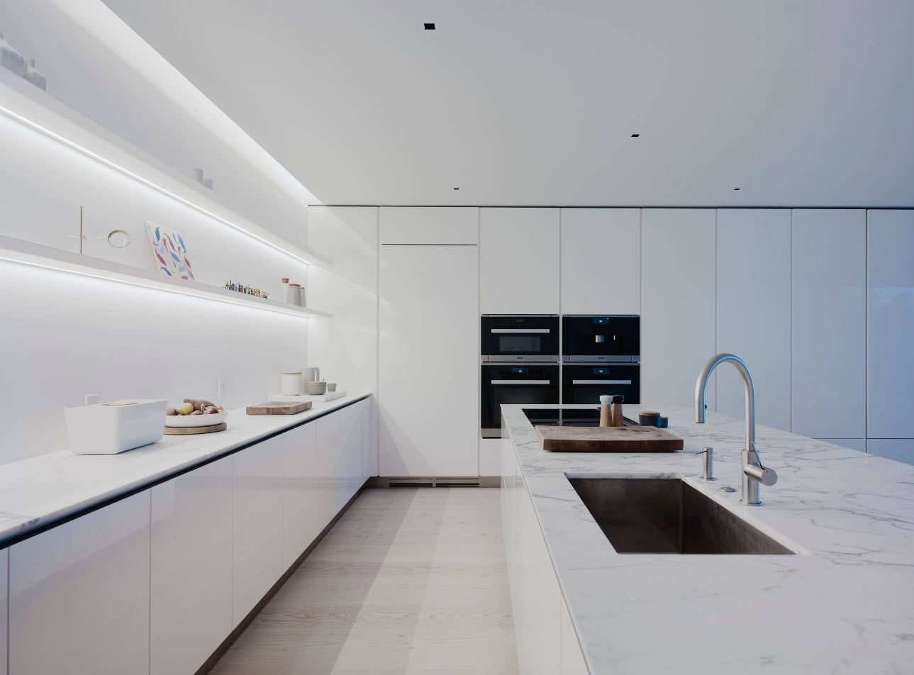 Hi-tech minimalism in the totally white kitchen with shelve-lighting