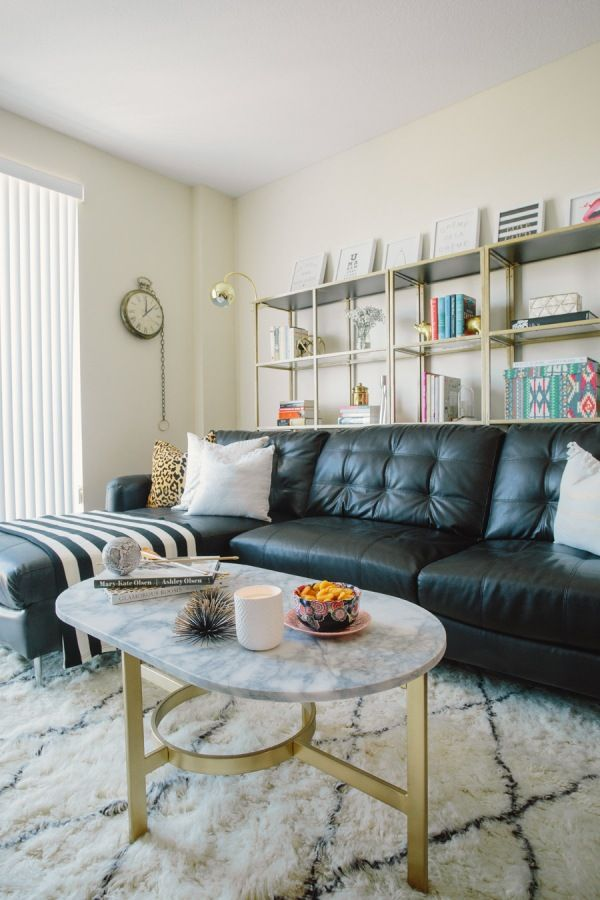 Open shelving in the contemporary styled living with large black sofa
