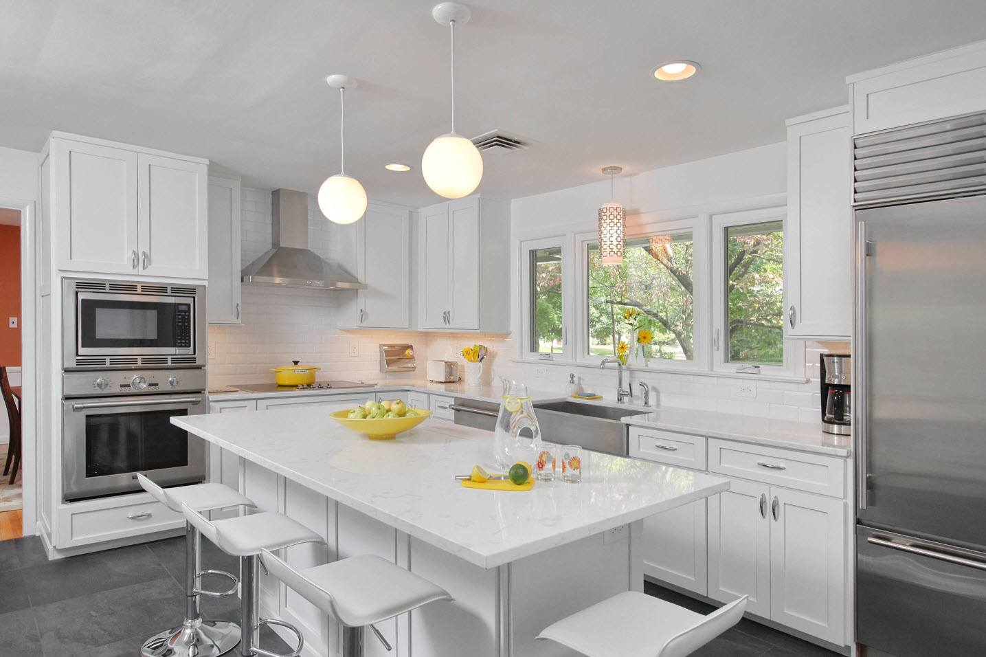 Typical though cozy kitchen interior in white coored classic style