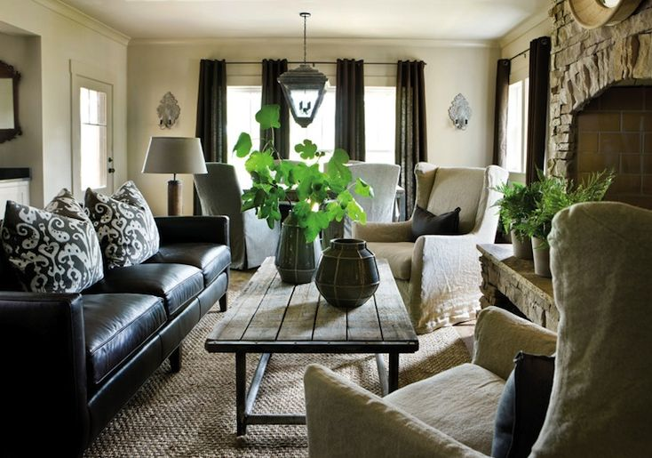 Black Sofa: Elegant and Original Design for Flawless Interior. Dark curtains in the room and wooden topped table