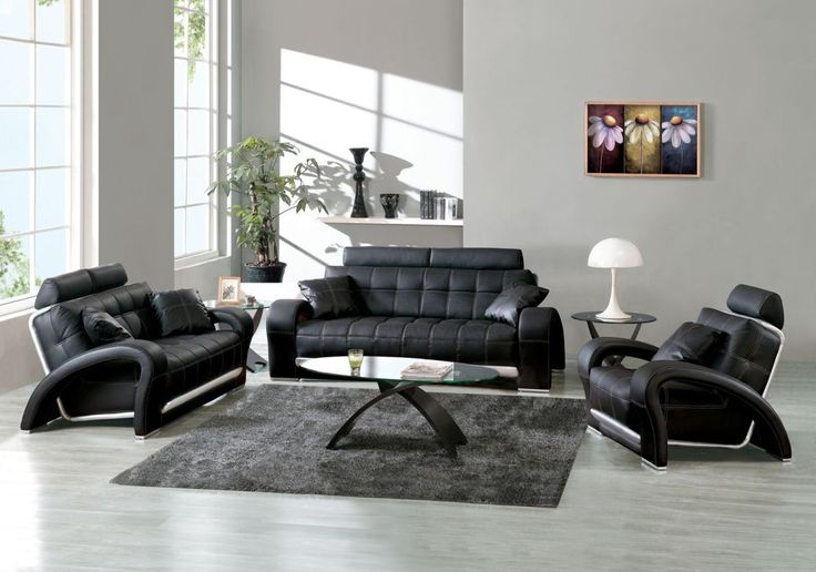 White designed room with accent black furniture at the living zone