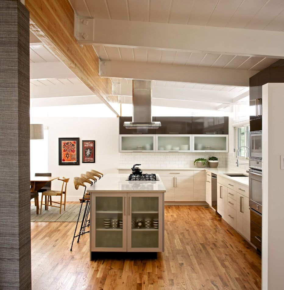 Loft styled kitchen with laminated floor and open constructions